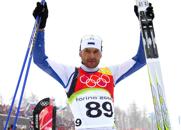 Estonia's Andrus Veerpalu raises his arms in jubilation after winning the men's 15km cross country skiing race at the Torino 2006 Winter Olympic Games in Pragelato, Italy, February 17, 2006. [Estonia's Veerpalu won the race ahead of Czech Republic's Lukas Bauer and Germany's Tobias Angerer.]