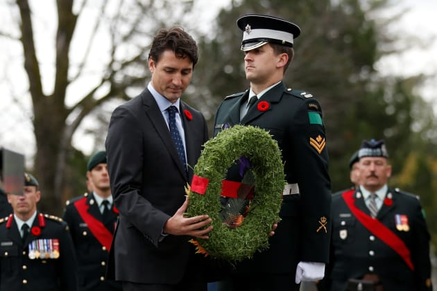 Here's Why Trudeau's Presence At Military Events Is An Insult To Veterans Dims?crop=2418%2C1613%2C0%2C0&quality=85&format=jpg&resize=630%2C420&image_uri=http%3A%2F%2Fo.aolcdn.com%2Fhss%2Fstorage%2Fmidas%2F514c8d35fc0b0b99d3d6c763cf51081f%2F206107163%2FRTS1ICYS