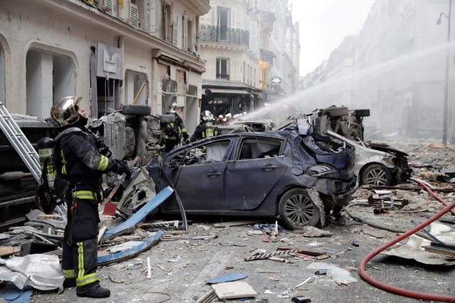 Paris bakery 'gas explosion': Two firefighters killed and dozens injured after huge blast in French capital