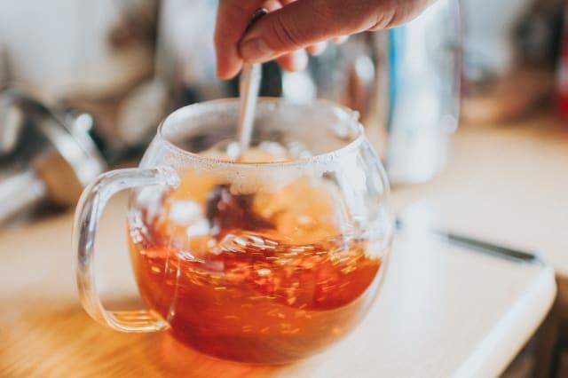 Man preparing cup of tea