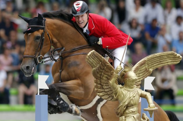 Canada's Ian Millar riding Dixson competes in the jumping first competition during the World Equestrian Games at the d'Ornano stadium in Caen September 2, 2014. REUTERS/Regis Duvignau (FRANCE - Tags: SPORT EQUESTRIANISM)