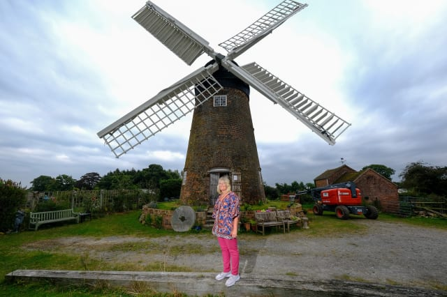 Woman completes ultimate DIY renovation project of one of Britain's last fully working windmills after using cherry picker to paint the sails by hand