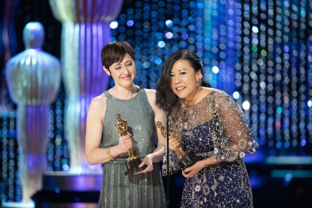 """Becky Neiman-Cobb and Domee Shi accept their Oscar for Best Animated Short for """"Bao."""""""