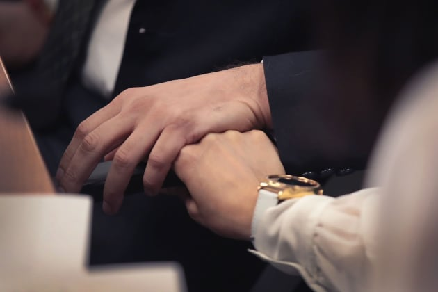 Manant Vaidya and his wife Hiral hold hands as they listen as their lawyer addresses the media on April 29, 2019 in Chicago, Illinois.