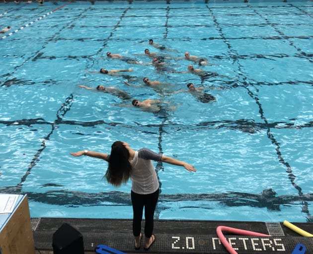 Head coach Holly Hjartarson works with the men's synchronized swimming team in Winnipeg.