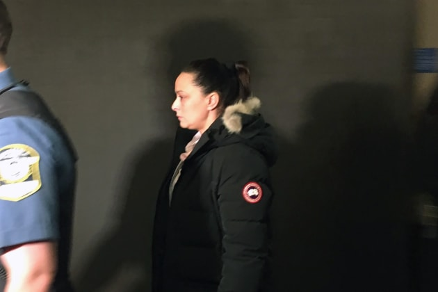 Virginia Genevrier, 40, leaves court after being sentenced in Montreal on Thursday.