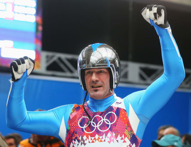 SOCHI, RUSSIA - FEBRUARY 09:  Armin Zoeggeler of Italy reacts after competing during the Men's Luge Singles on Day 2 of the Sochi 2014 Winter Olympics at Sliding Center Sanki on February 9, 2014 in Sochi, Russia.  (Photo by Alexander Hassenstein/Getty Images)