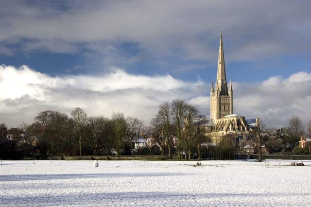 Norwich Cathedral and cricket field in the snow