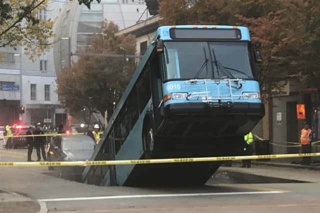 Sinkhole swallows part of city bus during rush hour