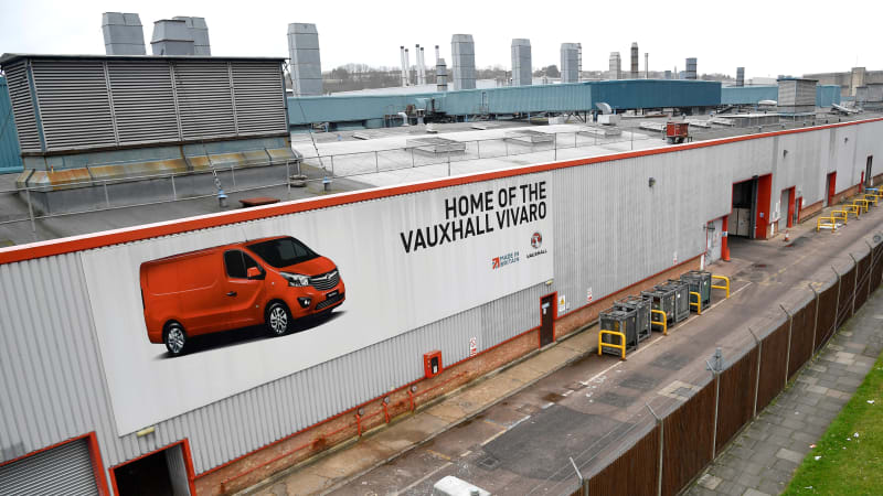 An advertising hoarding showing a Vauxhall Vivaro van is seen on a wall of the Vauxhall Luton plant in Luton