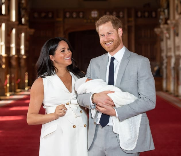 WINDSOR, ENGLAND - MAY 08: Prince Harry, Duke of Sussex and Meghan, Duchess of Sussex, pose with their newborn son Prince Archie Harrison Mountbatten-Windsor during a photocall in St George's Hall at Windsor Castle on May 8, 2019 in Windsor, England. The Duchess of Sussex gave birth at 05:26 on Monday 06 May, 2019. (Photo by Dominic Lipinski - WPA Pool/Getty Images)