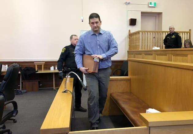 Trent Spencer Butt walks into the defendant's box at St. John's Supreme Court on Thursday.