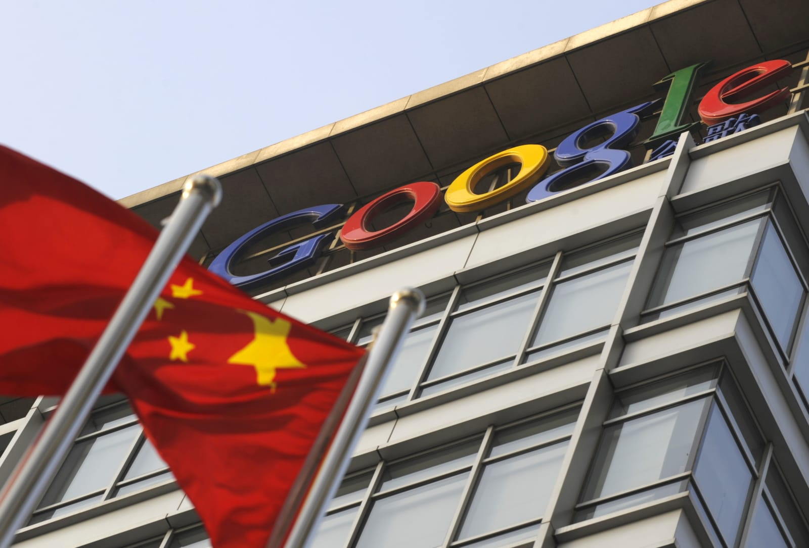 A Chinese flag flies over the company lo