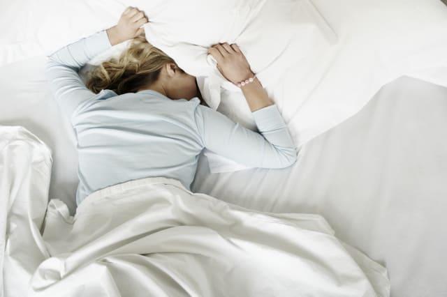 Woman having restless nights sleep