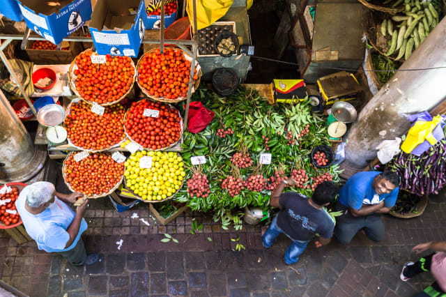 People shops for fresh fruits and vegetables in the traditional fresh market of Port Louis