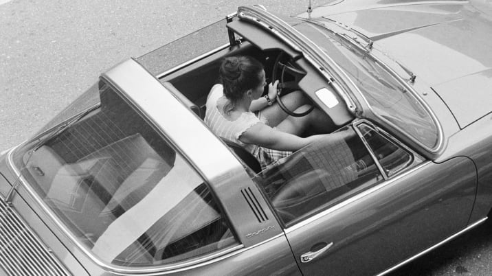 road traffic, young woman sits in a Porsche Targa with opened sunroof, birds-eye view, aged 20 to 30 years - 17.03.1973