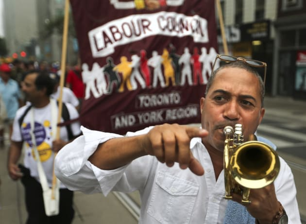 Photo of a demonstrator marching at the Annual Labour Day parade in Toronto on Sept. 1, 2014.