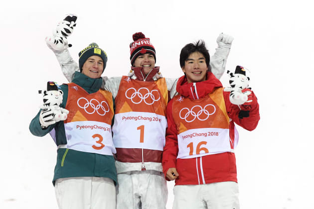 PYEONGCHANG-GUN, SOUTH KOREA - FEBRUARY 12:  (L-R) Silver medalist Matt Graham of Australia, gold medalist Mikael Kingsbury of Canada and bronze medalist Daichi Hara of Japan pose during the victory ceremony for the Freestyle Skiing Men's Moguls Final on day three of the PyeongChang 2018 Winter Olympic Games at Phoenix Snow Park on February 12, 2018 in Pyeongchang-gun, South Korea.  (Photo by David Ramos/Getty Images)