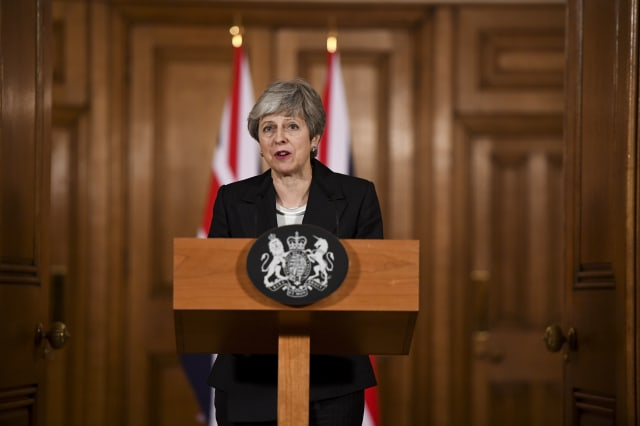 U.K. PM May Stuck in Brexit Fight Amid Reports of Short Delay