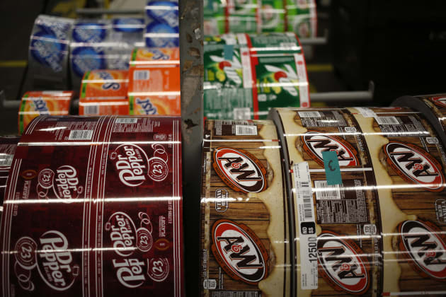 Rolls of plastic labels for Dr. Pepper Snapple Group Inc. brand sodas sit at the company s bottling plant in Irving, Tex., Tues. Oct. 25, 2016.