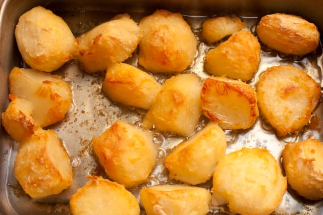 High Angle View Of Roasted Potatoes In Pan