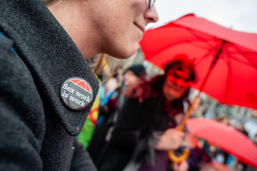 "An International Women's Day march participant wears a ""Sex work is real work"" pin, in this undated photo."