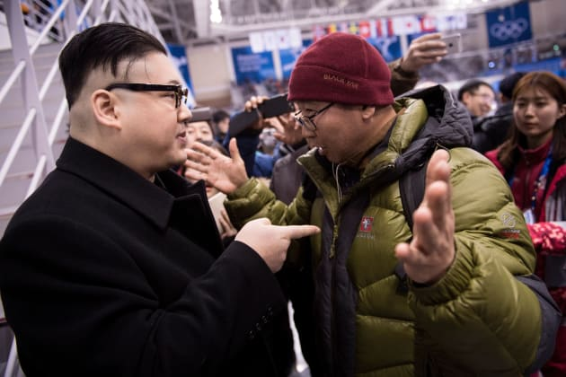 A Kim Jong Un impersonator is confronted during the final period of the women's preliminary round ice hockey match between Unified Korea and Japan during the Pyeongchang 2018 Winter Olympic Games at the Kwandong Hockey Centre in Gangneung, South Korea on February 14, 2018. / AFP PHOTO / Brendan Smialowski        (Photo credit should read BRENDAN SMIALOWSKI/AFP/Getty Images)