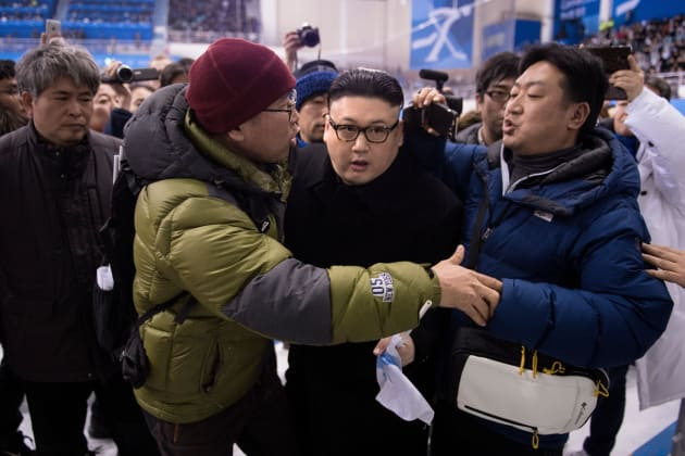 TOPSHOT - A Kim Jong Un impersonator is forced out in the final period of the women's preliminary round ice hockey match between Japan and the Unified Korean team during the Pyeongchang 2018 Winter Olympic Games at the Kwandong Hockey Centre in Gangneung on February 14, 2018.   / AFP PHOTO / Brendan Smialowski        (Photo credit should read BRENDAN SMIALOWSKI/AFP/Getty Images)