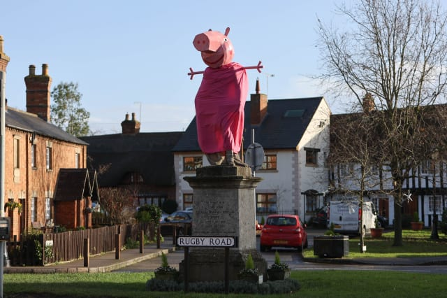 A village is hunting festive pranksters who have turned a statue of its most famous son into PEPPA PIG