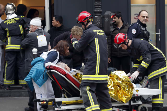 Two firefighters dead and dozens injured in explosion at Paris bakery