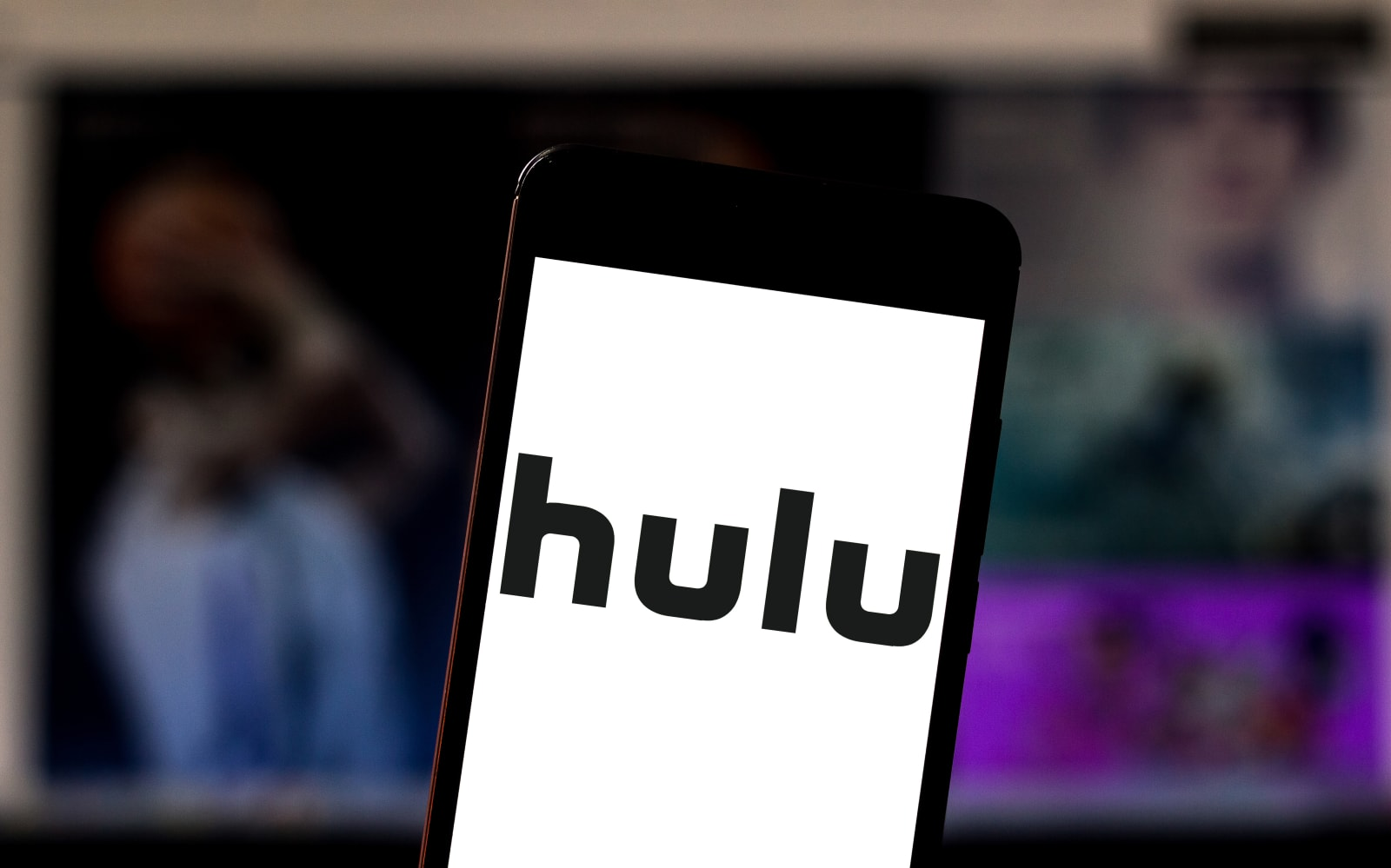In this photo illustration the Hulu logo is seen displayed...