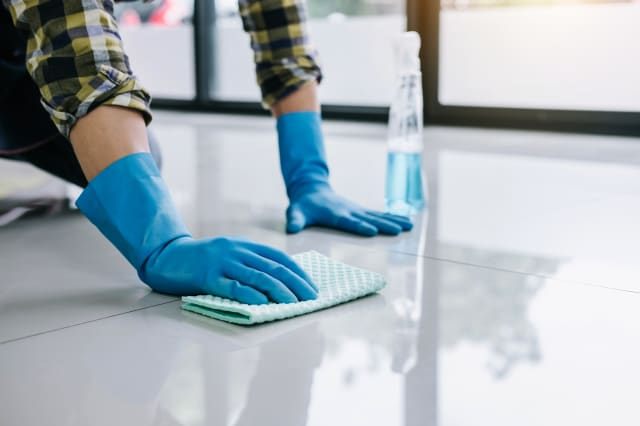 Man Cleaning Tiled Floor