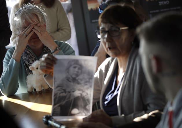 Sex abuse survivor Bernadette Howell (left) cries as she listens to Evelyn Korkamaz, another survivor,...