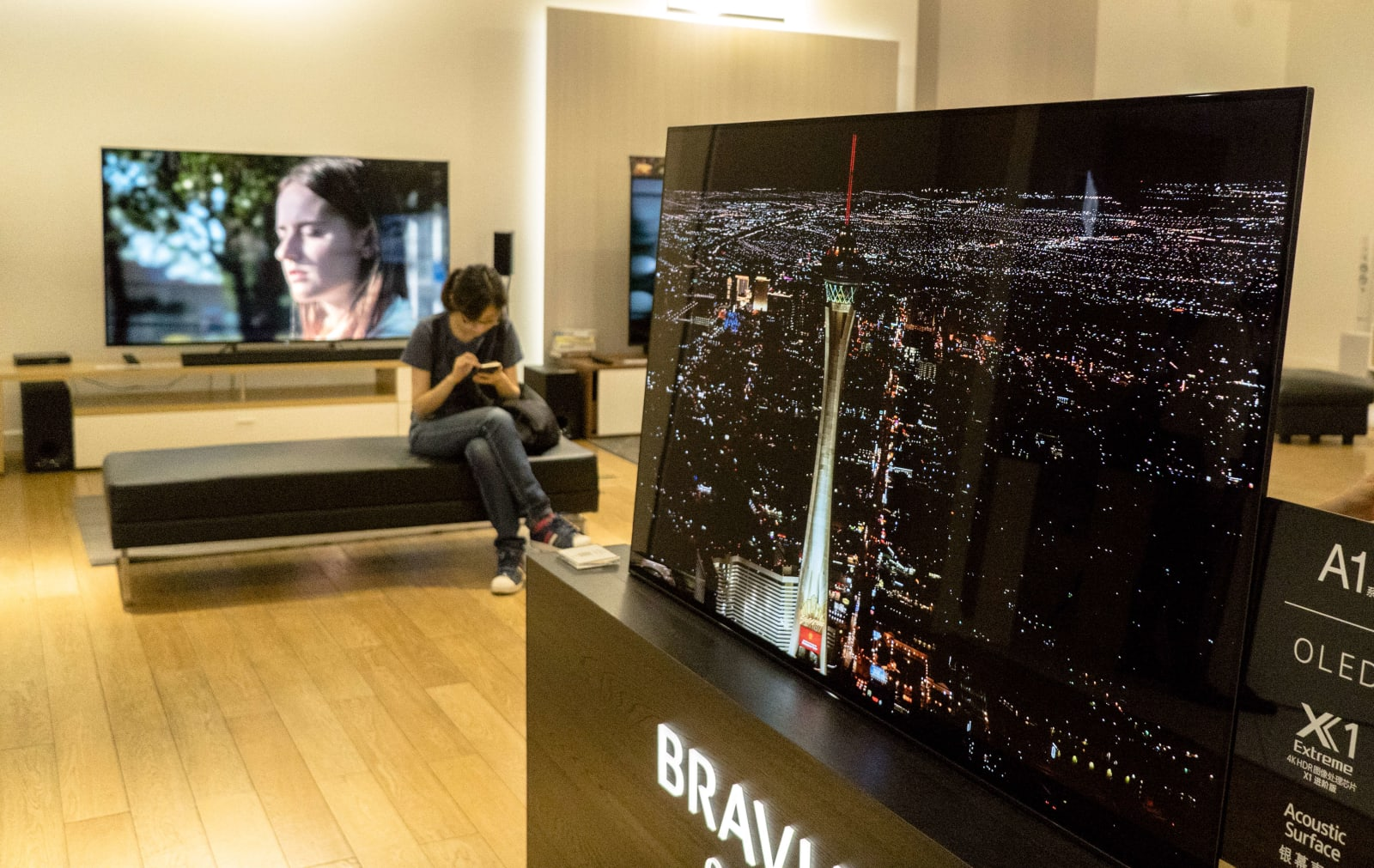 OLED TV sets in a Sony store.  During the May Day golden...