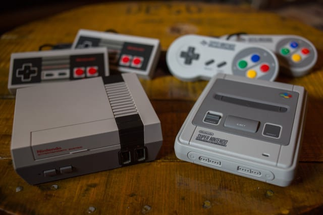 A NES (Nintendo Entertainment System) Classic Mini (L) and a