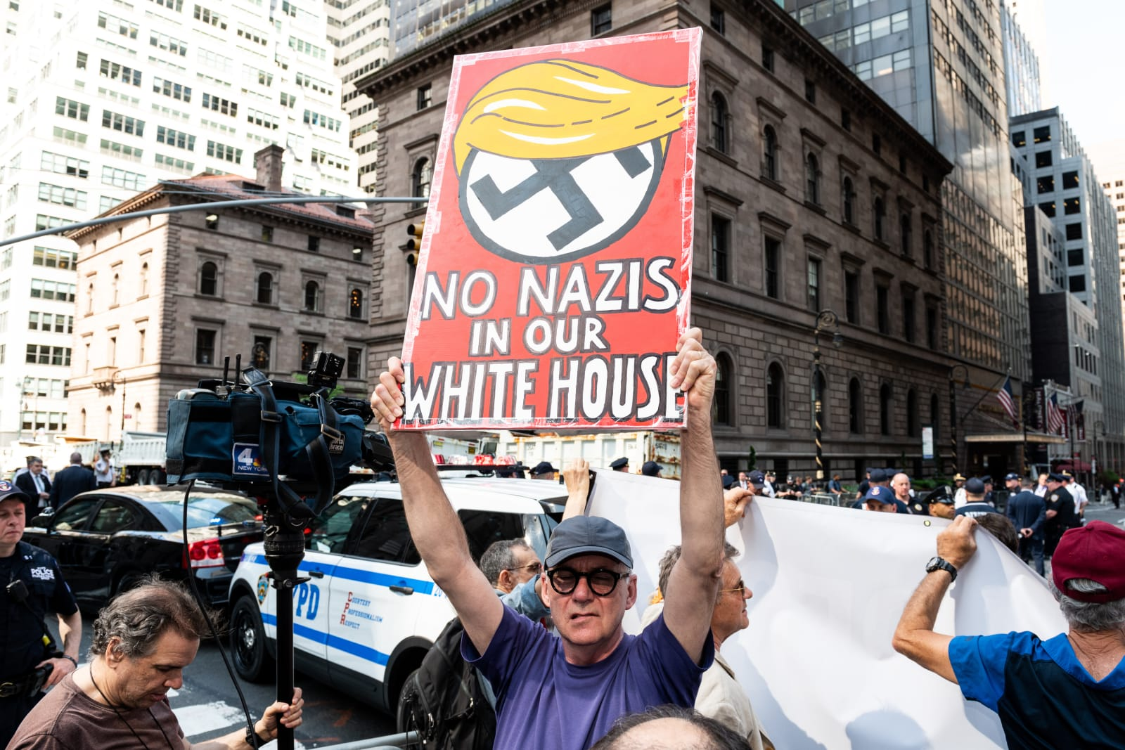 'No Nazis in our White House' sign at a protest rally...