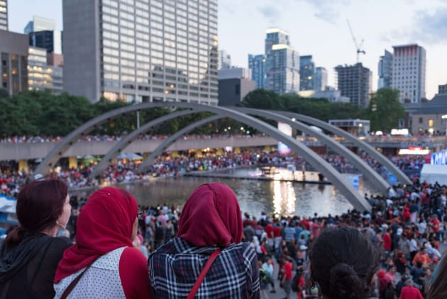 Muslim women celebrate Canada Day in Toronto's Nathan Phillips Square. A new survey shows that most Canadians...