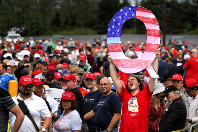 WILKES BARRE, PA - AUGUST 02: David Reinert holds up a large 'Q' sign while waiting in line to see President Donald J. Trump at his rally on August 2, 2018 at the Mohegan Sun Arena at Casey Plaza in Wilkes Barre, Pennsylvania. 'Q' represents QAnon, a conspiracy theory group that has been seen at recent rallies. (Photo by Rick Loomis/Getty Images)