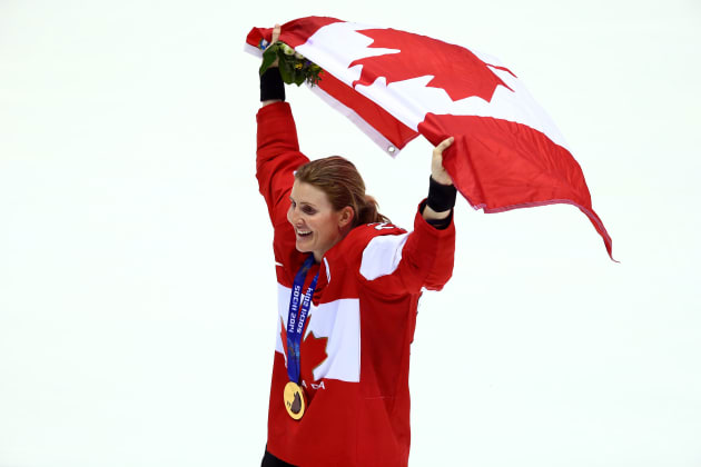 SOCHI, RUSSIA - FEBRUARY 20:  Gold medalist Hayley Wickenheiser #22 of Canada celebrates during the flower ceremony for the Ice Hockey Women's Gold Medal Game on day 13 of the Sochi 2014 Winter Olympics at Bolshoy Ice Dome on February 20, 2014 in Sochi, Russia.  (Photo by Doug Pensinger/Getty Images)