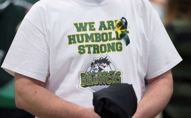A man wears a Humboldt Broncos shirt during a vigil at the Elgar Petersen Arena, home of the Humboldt Broncos, to honour the victims of the fatal bus accident.
