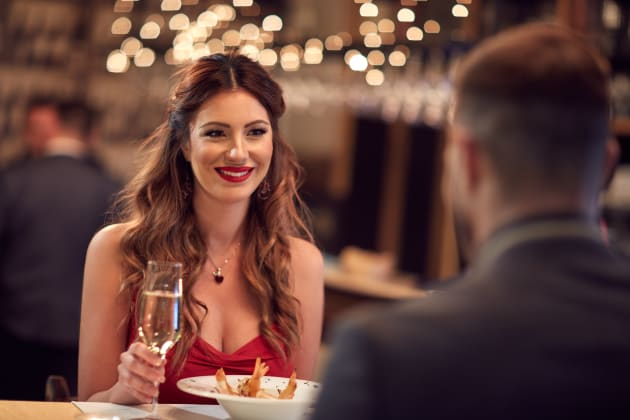 Couple celebrate Valentine's day with romantic dinner in restaurant