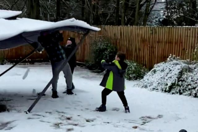 Watch the moment a dad tried shower his kids in snow from the top of a gazebo, but the prank backfires when it collapses on top of him!