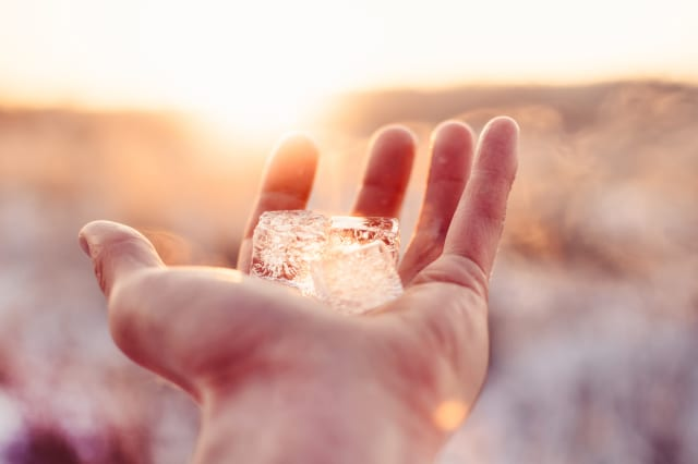 Cropped Hand Of Person Holding Ice