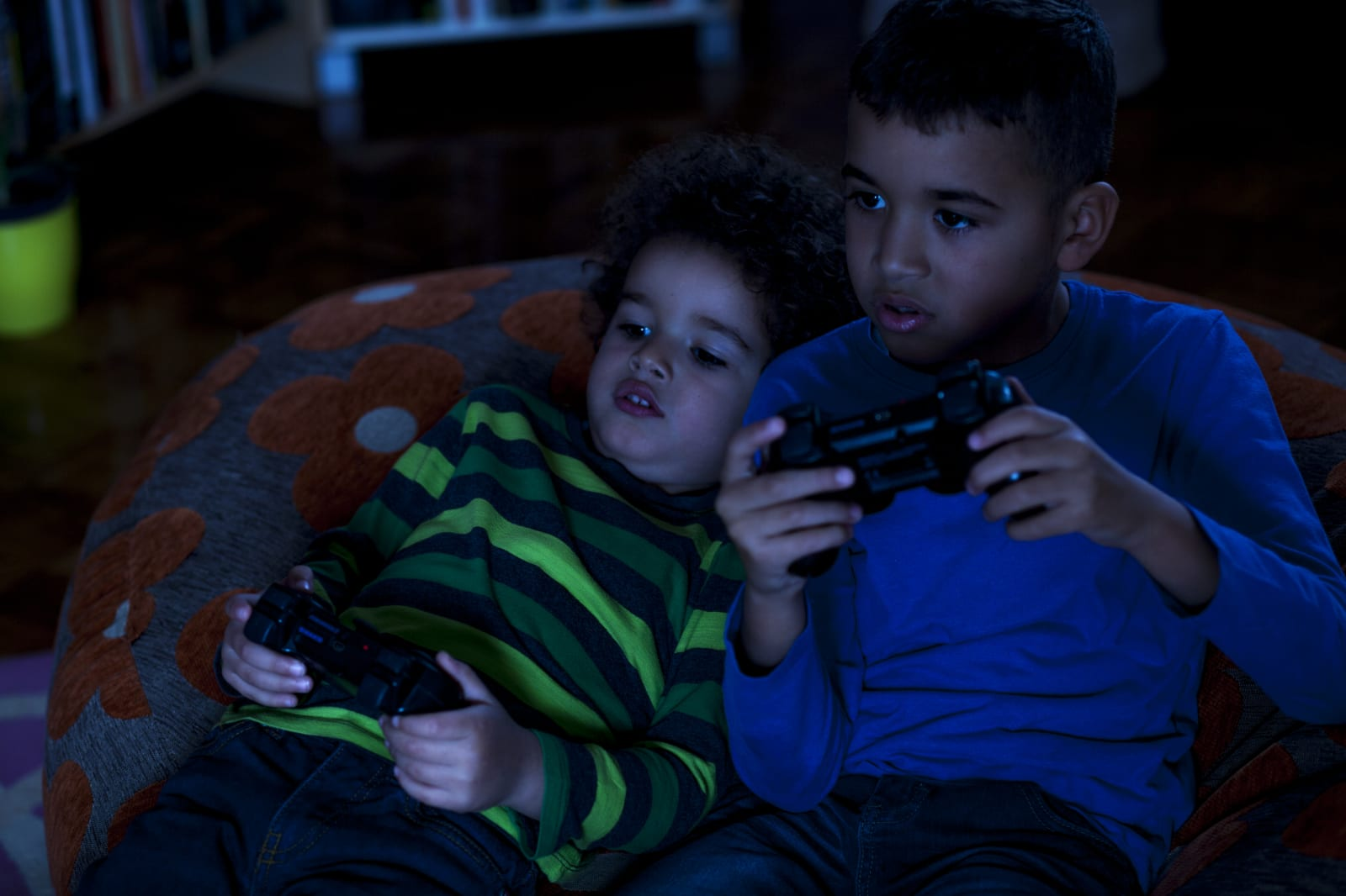 Two Friends Playing Video Game, at Night