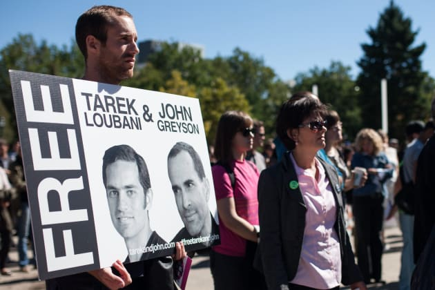 Friends, family and colleagues of Tarek Loubani gather at a rally in Victoria Park in London, Ont. on Sept. 24, 2013, calling on the former Conservative government to become more involved in negotiating the release of Loubani and John Greyson.