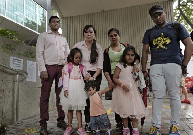 Asylum seekers, from left: Ajith Pushpa Kumara, Vanessa Mae Rodel and her daughter Keana, Nadeeka Dilrukshi...