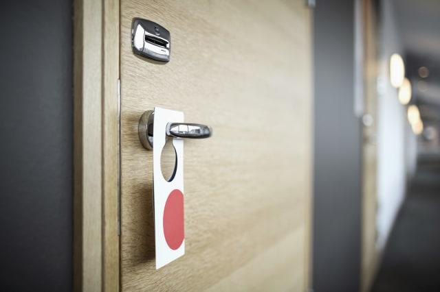 Label hanging on hotel door handle