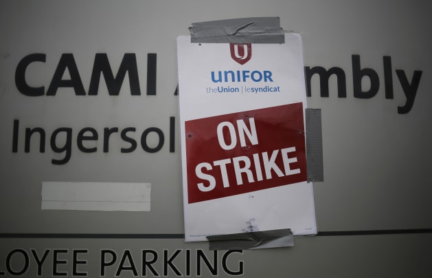 Chris Helgren / Reuters A strike poster from the auto workers union Unifor is posted at a picket line outside the General Motors Co CAMI assembly plant in ...