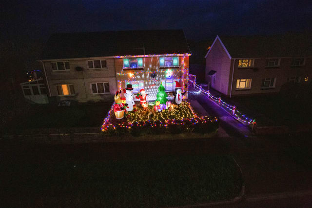 Mum goes all out to cheer up her kids and neighbours by putting up her CHRISTMAS decorations three months early - including 3,000 outdoor lights