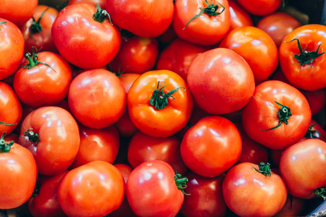 red tomatoes texture overhead. background vegetables